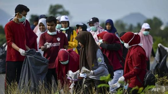 Hàng ngàn người khắp châu Á xuống đường lượm rác nhân Ngày dọn dẹp thế giới - Ảnh 3.