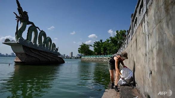 Hàng ngàn người khắp châu Á xuống đường lượm rác nhân Ngày dọn dẹp thế giới - Ảnh 1.
