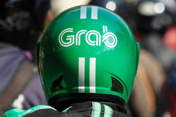 Malaysia điều tra hành vi độc quyền của Grab - Ảnh 1.