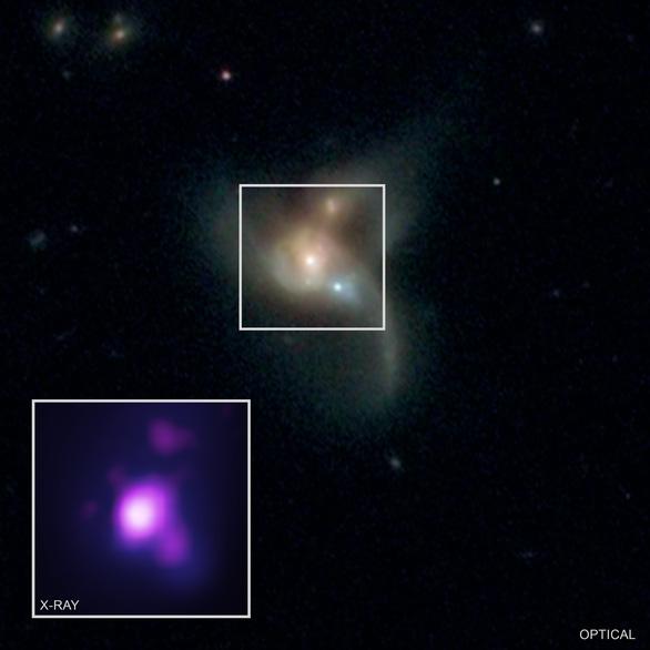 Lần đầu tiên phát hiện ba hố đen khổng lồ sau va chạm thiên hà - Ảnh 1.