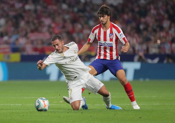 Hòa tẻ nhạt trong trận derby thành Madrid, Real Madrid chỉ hơn Barca 2 điểm - Ảnh 1.