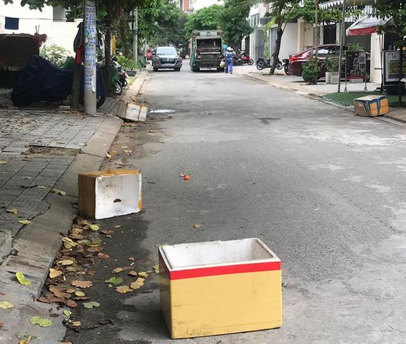 Tranh cãi trách nhiệm bỏ rác lên xe thu gom thuộc về ai ? - Ảnh 1.