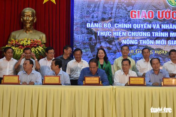 Người dân An Giang đóng góp trên 1.477 tỉ đồng xây dựng nông thôn mới - Ảnh 1.