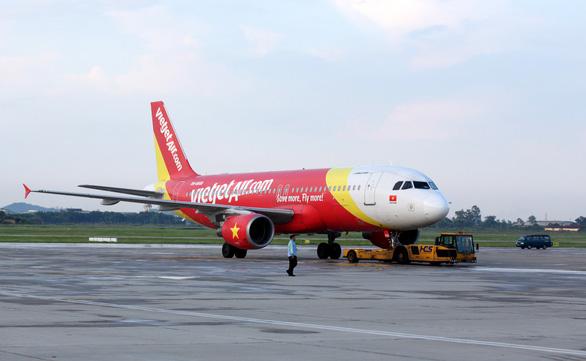 Vietjet Air xin tự lo dịch vụ mặt đất tại Nội Bài và Cam Ranh - Ảnh 1.