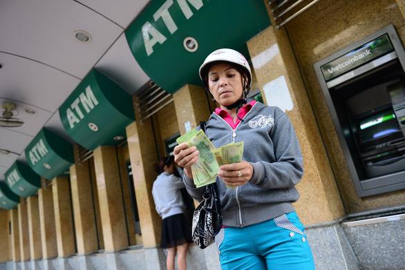 Yêu cầu đảm bảo hệ thống ATM hoạt động thông suốt tết tại TP.HCM - Ảnh 1.
