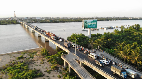 Cấm xe trên 16 tấn qua cầu Rạch Miễu theo giờ từ 17-1 - Ảnh 3.