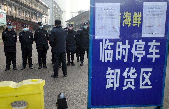 WHO: Bệnh phổi lạ ở Trung Quốc lây từ người sang người, nguy cơ bùng phát - Ảnh 1.