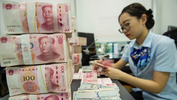 Mỹ đưa Trung Quốc ra khỏi danh sách quốc gia thao túng tiền tệ - Ảnh 1.