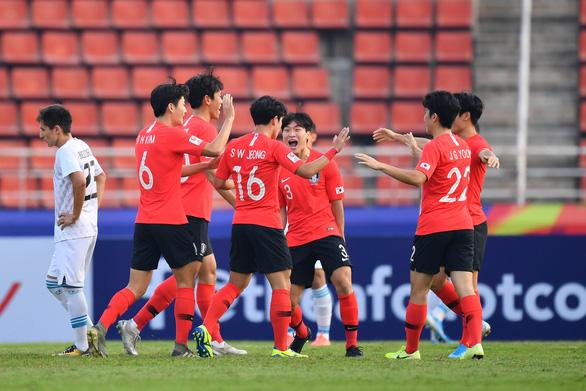 Thua U23 Hàn Quốc, đương kim vô địch Uzbekistan vẫn có mặt ở tứ kết - Ảnh 1.
