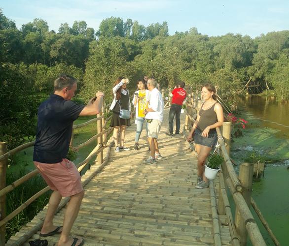 Cầu tre dài nhất Việt Nam và rừng tràm Trà Sư lập kỷ lục Việt Nam - Ảnh 3.