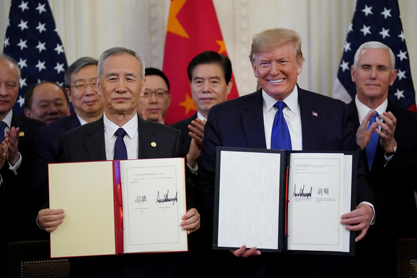 Ký thỏa thuận thương mại với Mỹ, Bắc Kinh hứa thực thi nghiêm túc - Ảnh 1.
