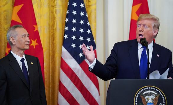 Ký thỏa thuận thương mại với Mỹ, Bắc Kinh hứa thực thi nghiêm túc - Ảnh 2.