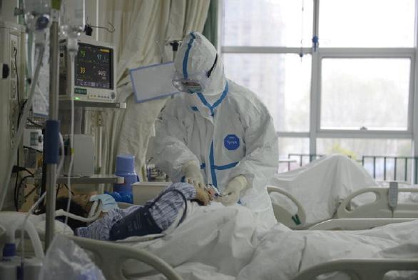 Trung Quốc xây bệnh viện 1.000 giường trong cuối tuần để đối phó virus corona - Ảnh 1.