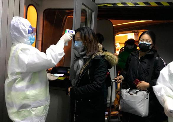 Trung Quốc cách ly 8 thành phố ngăn dịch viêm phổi cấp - Ảnh 1.