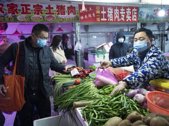 Số ca nhiễm virus corona ở Trung Quốc chính thức vượt số người bệnh SARS - Ảnh 1.