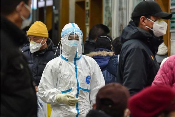 Phát hiện bất ngờ: Ca nhiễm virus corona đầu tiên không liên quan chợ hải sản Vũ Hán - Ảnh 1.