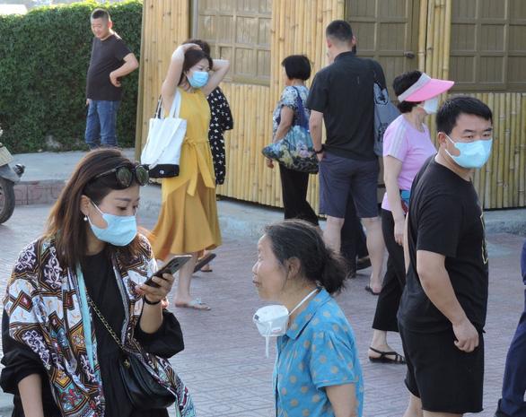 Sợ virus corona, khách Trung Quốc bịt kín khẩu trang ở Khánh Hòa - Ảnh 3.