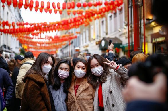 Trung Quốc cấm dân đi du lịch nước ngoài từ ngày 27-1 - Ảnh 1.