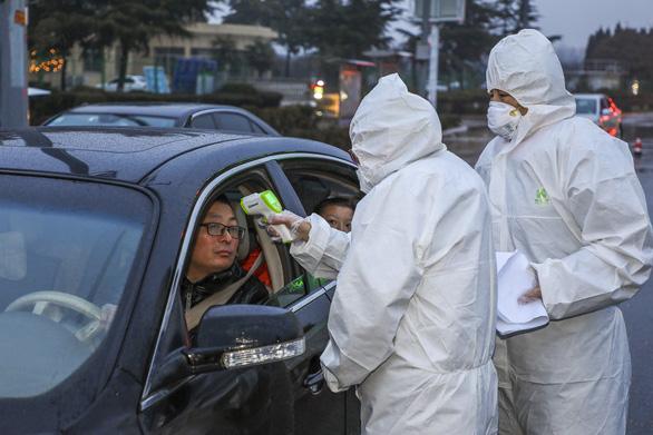 Trung Quốc chi gần 9 tỉ USD để chống viêm phổi Vũ Hán - Ảnh 1.