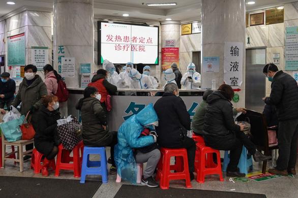 Chuyên gia nói có 44.000 ca nhiễm virus corona ở Vũ Hán, kêu gọi biện pháp hà khắc - Ảnh 1.