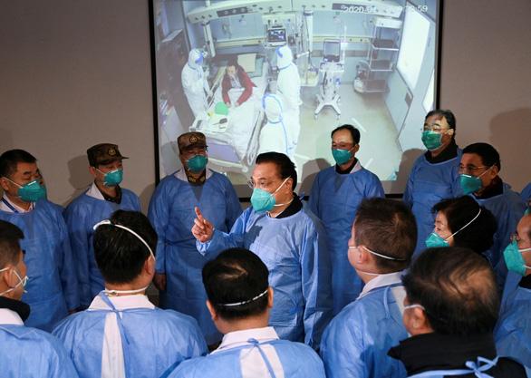 106 người chết do virus corona ở Trung Quốc, Bắc Kinh đã có trường hợp tử vong đầu tiên - Ảnh 1.