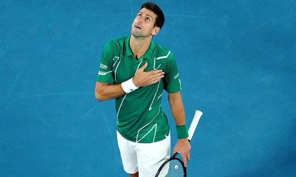 Đánh bại Raonic, Djokovic gặp Federer ở bán kết giải Úc mở rộng 2020 - Ảnh 1.
