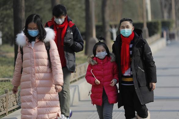 Tòa tối cao Trung Quốc tha cho nhóm người loan tin đồn về dịch corona - Ảnh 1.
