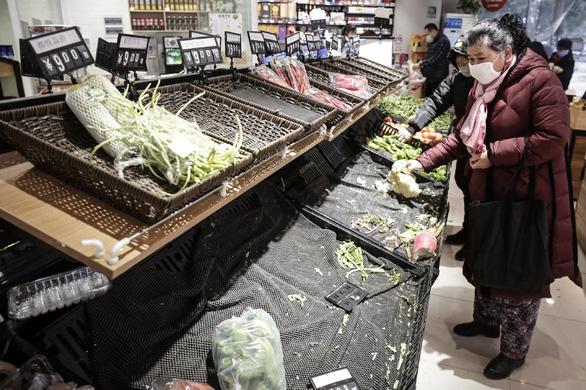 Bắc Kinh buộc các nơi cấp lương thực cho Vũ Hán đang bị phong tỏa - Ảnh 1.