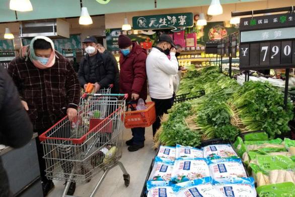 Bắc Kinh buộc các nơi cấp lương thực cho Vũ Hán đang bị phong tỏa - Ảnh 2.