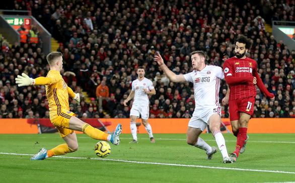 Thắng nhẹ nhàng Sheffield, Liverpool vững chắc ngôi đầu Premier League - Ảnh 1.