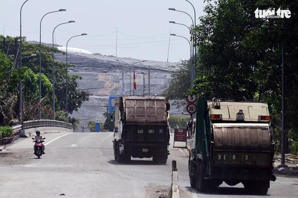 Bãi rác Đa Phước sẽ hết hôi khi… đóng cửa vào năm 2024 - Ảnh 1.