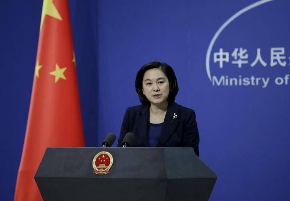Trung Quốc quyết hồi hương người Vũ Hán trốn ra nước ngoài - Ảnh 1.