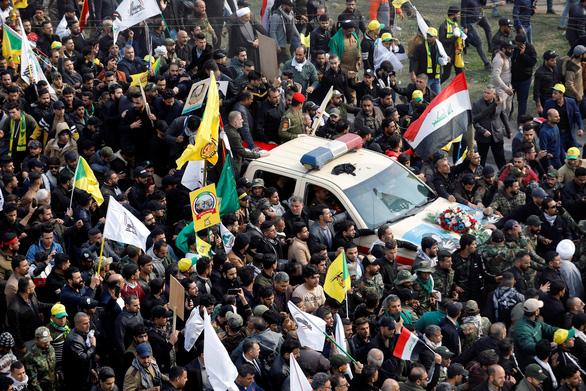 Hàng ngàn người Iraq dự lễ tang tướng Iran, hô vang Cái chết cho nước Mỹ - Ảnh 1.