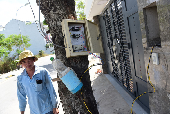 Khu tái định cư thiếu điện, nước: Các bên đùn đẩy trách nhiệm - Ảnh 1.