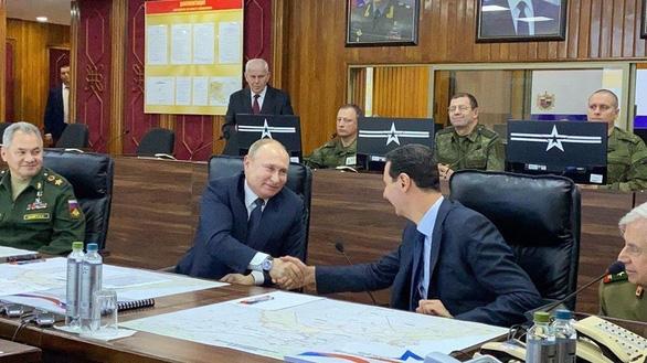 Đức đổ lỗi cho Iran, Tổng thống Nga Putin bất ngờ tới Syria - Ảnh 1.