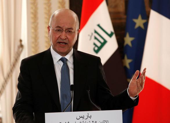 Tổng thống Iraq lên án hành động đáp trả Mỹ của Iran - Ảnh 1.