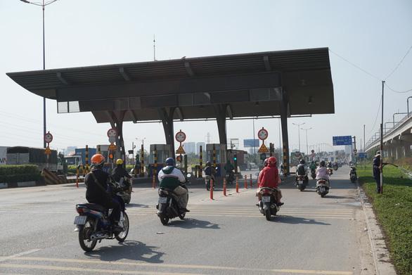 TP.HCM yêu cầu rà soát hợp đồng, khảo sát lưu lượng xe ở BOT Xa lộ Hà Nội - Ảnh 1.