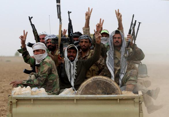 Liên minh dân quân Hashd al-Shaabi: Từ cướp đường thành thế lực chính trị - Ảnh 2.