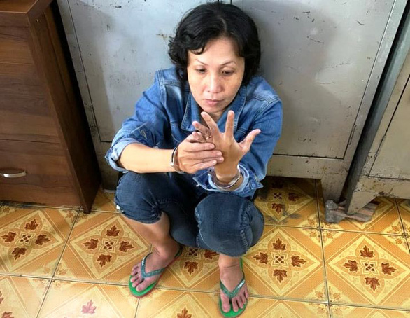 Đã bắt người phụ nữ xúi con nuôi lấy tiền bà bán nước trên đường Lê Văn Sỹ - Ảnh 1.