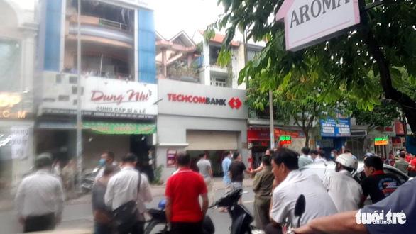 Bắt cô gái đi taxi cướp hơn 2 tỉ của Ngân hàng Techcombank ở Tân Phú - Ảnh 2.