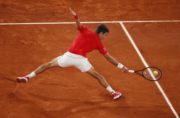 Thắng gọn Djokovic, Nadal lần thứ 20 vô địch Grand Slam - Ảnh 4.