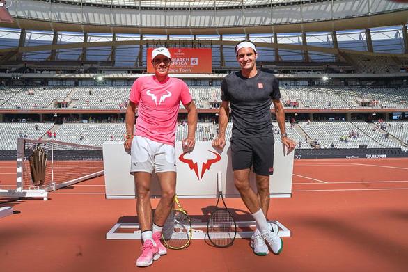 Federer viết Facebook chúc mừng kình địch vĩ đại Nadal giành Grand Slam thứ 20 - Ảnh 1.