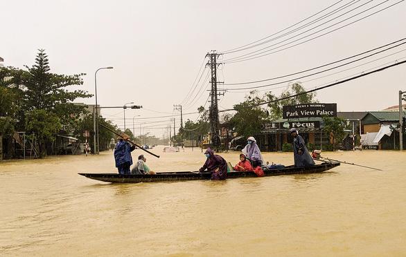 Ngập lụt kéo dài sẽ rất căng thẳng - Ảnh 1.