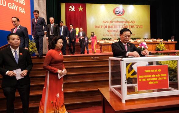 Hà Nội ủng hộ 7 tỉ đồng giúp 5 tỉnh miền Trung khắc phục lũ bão - Ảnh 1.