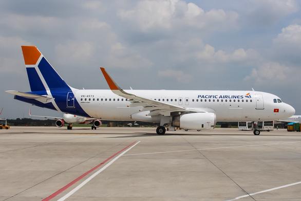 Tập đoàn Qantas tặng Vietnam Airlines 30% cổ phần tại Pacific Airlines - Ảnh 1.