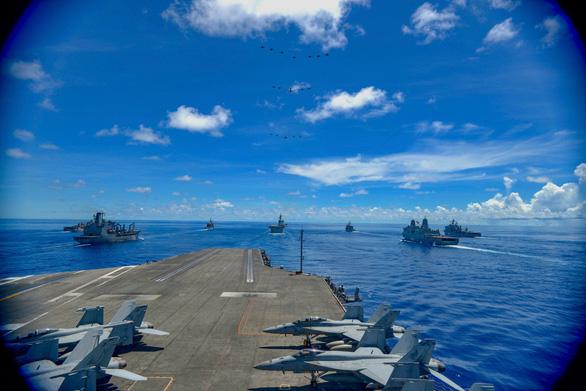 Tàu sân bay USS Ronald Reagan quay lại Biển Đông lần thứ 3 trong năm - Ảnh 1.