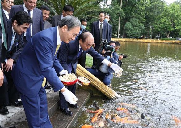 Tổng bí thư, Chủ tịch nước Nguyễn Phú Trọng tiếp Thủ tướng Nhật Bản Suga Yoshihide - Ảnh 2.