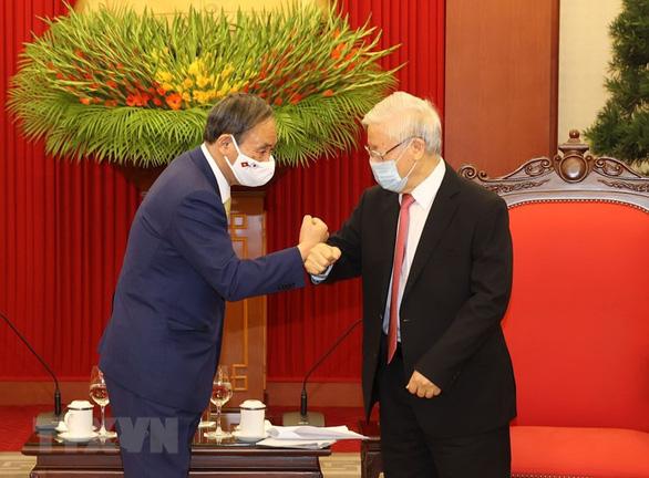 Tổng bí thư, Chủ tịch nước Nguyễn Phú Trọng tiếp Thủ tướng Nhật Bản Suga Yoshihide - Ảnh 1.