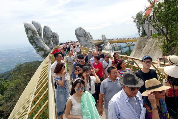 Đón khách quốc tế, mở cửa từng bước - Ảnh 1.
