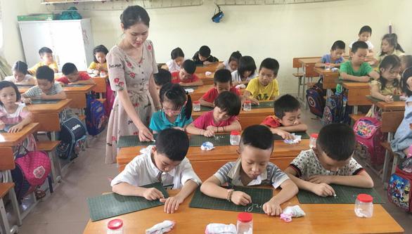 Chương trình lớp 1 mới: Dạy con học như một cuộc chiến - Ảnh 1.